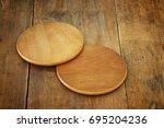 image of wooden beer coasters... | Shutterstock . vector #695204236