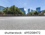 empty road with modern business ... | Shutterstock . vector #695208472