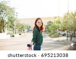 young happy asia woman with... | Shutterstock . vector #695213038