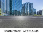 empty road with modern business ... | Shutterstock . vector #695216335