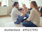 smiling young mother and father ... | Shutterstock . vector #695217592
