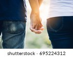 couples holding hands.summer in ... | Shutterstock . vector #695224312