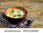 chicken soup with noodles and... | Shutterstock . vector #695226982
