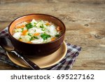 chicken soup with noodles and... | Shutterstock . vector #695227162
