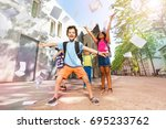 happy boy throws papers in the... | Shutterstock . vector #695233762