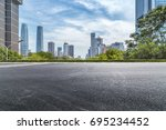 empty road with modern business ... | Shutterstock . vector #695234452