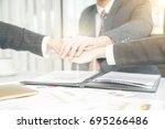 business partner woman and man... | Shutterstock . vector #695266486
