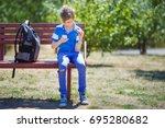 schoolboy playing with fidget...   Shutterstock . vector #695280682