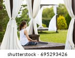 young girl doing yoga or...   Shutterstock . vector #695293426
