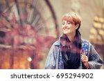 beautiful woman. city scenes....   Shutterstock . vector #695294902