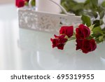 Stock photo romantic red roses on table 695319955