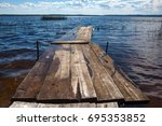 Close Up Of Old  Wooden Jetty...