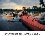 happy young couple in sea vests ... | Shutterstock . vector #695361652