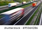trucks on four lane controlled... | Shutterstock . vector #695364286