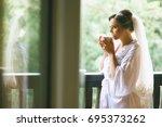 morning bride before the wedding | Shutterstock . vector #695373262