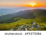 sunset in the mountains   Shutterstock . vector #695375086