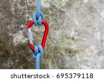 red carabiner with climbing... | Shutterstock . vector #695379118