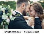 cheerful wedding couple hugs on ... | Shutterstock . vector #695388505