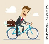businessman ride a bike to work ... | Shutterstock .eps vector #695407492