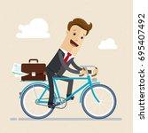 businessman ride a bike to work ...   Shutterstock .eps vector #695407492