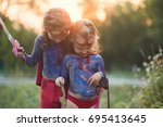 happy children play superheroes ... | Shutterstock . vector #695413645