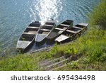 four boats by the lake   Shutterstock . vector #695434498