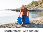 man in sunglasses with luggage... | Shutterstock . vector #695435002