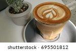 latte art  | Shutterstock . vector #695501812