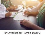 medical team having a meeting... | Shutterstock . vector #695510392