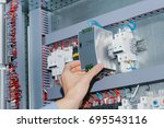 electrician specialist checking ... | Shutterstock . vector #695543116