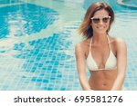 woman sitting at the swimming... | Shutterstock . vector #695581276