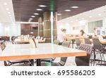 Stock photo modern interior of cafeteria or canteen with chairs and tables nobody 695586205
