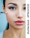 beauty treatment with botox. | Shutterstock . vector #695614132