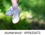 dangling hanging female legs of ...   Shutterstock . vector #695632672