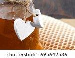 jars of honey bee honeycomb and ... | Shutterstock . vector #695642536
