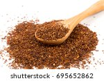 heap of red dry rooibos healthy ... | Shutterstock . vector #695652862