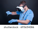 surgeon wearing scrubs and face ... | Shutterstock . vector #695654086