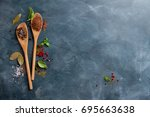 wooden spoons with spices on...   Shutterstock . vector #695663638