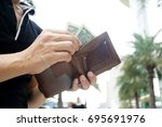 man carrying a wallet in hand ... | Shutterstock . vector #695691976