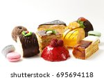 assorted mini cakes sweet... | Shutterstock . vector #695694118