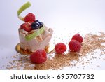 fruit cake and red berries | Shutterstock . vector #695707732