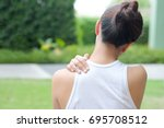 Small photo of Women have neck pain, shoulder pain, at the park health concept.