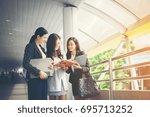 businesswomen discussing over...   Shutterstock . vector #695713252