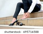 women with leg cramps and... | Shutterstock . vector #695716588
