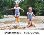 happy funny sisters twins ... | Shutterstock . vector #695723908