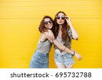 Image of two young happy women...