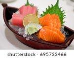 fresh salmon sashimi and tuna... | Shutterstock . vector #695733466