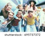 group of friends having fun in... | Shutterstock . vector #695737372