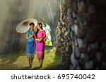 woman wearing laos traditional... | Shutterstock . vector #695740042