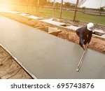 leveling concrete with trowels  ... | Shutterstock . vector #695743876